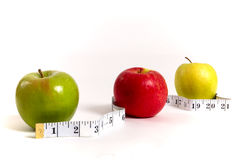 Slimming through apples Stock Images