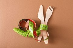 Tape measure wrapped around knife and fork Royalty Free Stock Photo