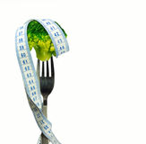 Slimming broccoli. Broccoli with a tape around it on a folk Stock Images