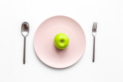 Slimming diet. Apple at plate on white background top view Royalty Free Stock Photos
