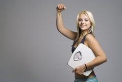 Slimming o peso da dieta do alvo do bicep do sucesso da mulher Fotografia de Stock Royalty Free