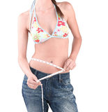 Slimming woman measuring her waist Royalty Free Stock Photos