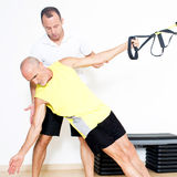 Sling suspension stretching exercise royalty free stock photography
