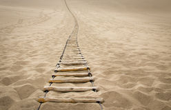 Sling wood stair on desert. Sling wood stair on the sand Royalty Free Stock Photography
