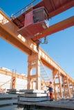 Slinger with crane operator work on loading Stock Images