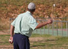 Slinger tournament in Mallorca. A  man uses a slinger to throw a stone during a local Slingshot tournament in the Spanish island of Mallorca Stock Photo