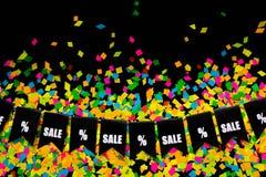 Slinger van vlaggen op de achtergrond van gekleurde confettien Zwart Fr Royalty-vrije Stock Afbeeldingen