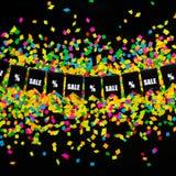 Slinger van vlaggen op de achtergrond van gekleurde confettien Zwart Fr Royalty-vrije Stock Foto's