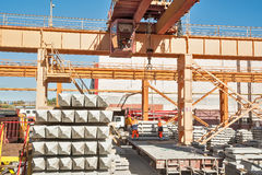 Slinger on workplace. Loading of products. Crane Stock Image