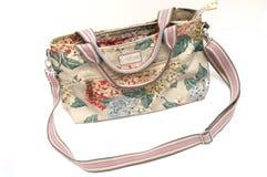 Slingeren de kleurrijke dames zak met bloemendrukken stock fotografie