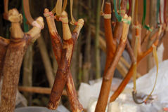 Slingshot. Many beige Color Slingshots that made from wood hang from the bar Stock Image
