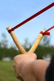 Slingshot aimed and ready Stock Photo