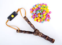 Slingshot And Candies Royalty Free Stock Photos