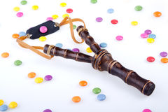Slingshot and candies  Stock Photos