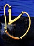 Slingshot and jeans. Wooden slingshot in blue jeans bag Royalty Free Stock Photo