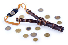 Slingshot and money Royalty Free Stock Images
