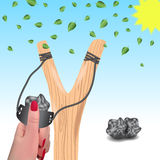 Slingshot przeciw tłu spada liście Slingshot w a Obraz Stock