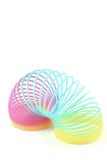 Slinky. Colorful slinky on a white background using portrait mode Stock Image