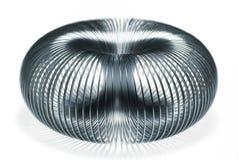 Slinky fun. Metal slinky creating a symmetrical spherical pattern Stock Photography