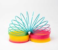Slinky - a rainbow colored plastic toy stock images