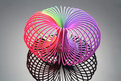 Slinky Toy. With Reflection on White Background Stock Images