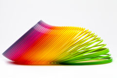 Slinky Toy. Over a plain white background stock image