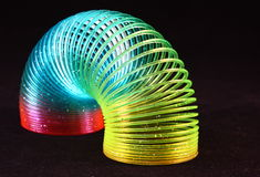 Slinky Toy. Over a plain black background. Rainbow Spiral toy Royalty Free Stock Photos