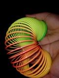 Slinky toy rainbow color stock image