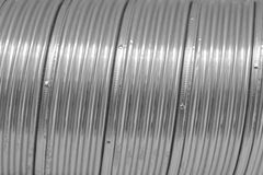 Sliny metal background. Sliny metal pipe closeup background royalty free stock photos