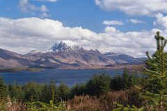 Slioch over loch. Slioch, a mountain overlooking Loch Maree in Scotland stock photography