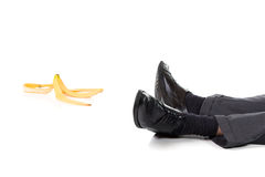 Slip and fall. A scene of a slip and fall accident with banana peel. Isolated on white background Royalty Free Stock Photos