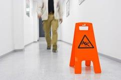 Slip hazard. Warning sign Slip hazard in a corridor royalty free stock photography