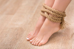 Slip legs bound with rope Stock Images