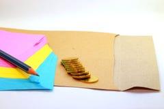 Slippad, monedas, envuelve y dibuja a lápiz imágenes de archivo libres de regalías