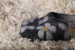 Slipper. Handmade felt slipper on the goat skin stock photo