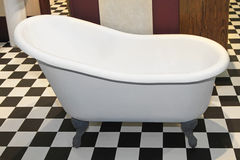 Slipper bathtub. VIntage style slipper bathtub in checker bathroom Stock Photo