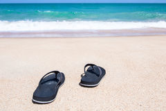 Slipper on beach Royalty Free Stock Photography