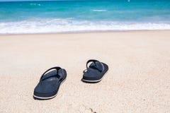 Slipper on beach. Slipper on white sand beach Stock Images