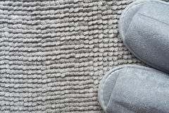 Slipper on gray carpet Stock Photo