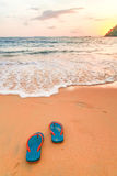 Slipper and sunset on the beach. In thailand royalty free stock photos