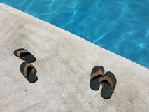 Slipper beside swimming pool Stock Images