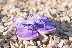 Slippers and bag at sunny beach and summer season Royalty Free Stock Images