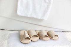 Slippers and bath towel by the bathtub Royalty Free Stock Photos