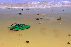 Slippers on the beach Royalty Free Stock Photography