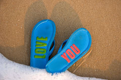 Slippers on beach. Lovely slippers on the beach Stock Photo