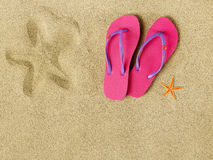 Slippers on beach Royalty Free Stock Images