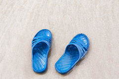 Slippers on the beach Stock Photography