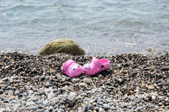 Slippers on beach Royalty Free Stock Photos
