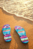 Slippers on the beach Royalty Free Stock Photo