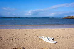 Slippers on beach Royalty Free Stock Image